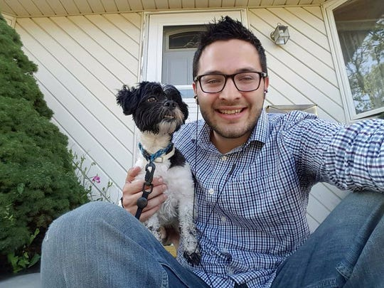 Fellow Pokemon Go fans, William Kimbark and his dog