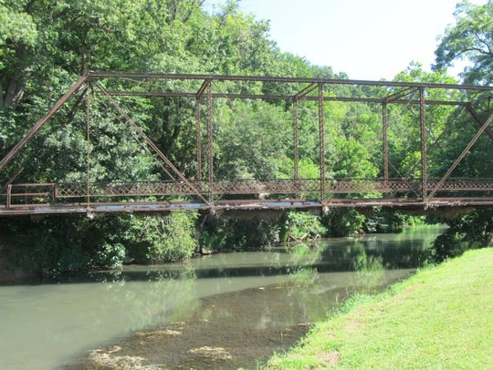 An old bridge over Capps Creek trout stream at Jolly