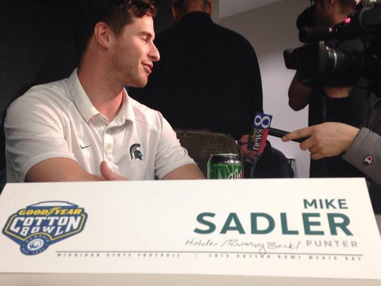 Mike Sadler gets interviewed at MSU's Cotton Bowl media