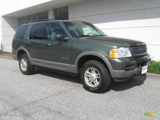 A green Ford Explorer.