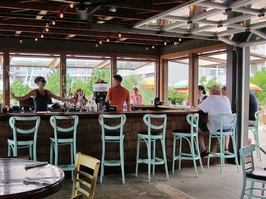 The Rusty Nail open air bar is a popular gathering place just off the beach in Cape May. Walk up from the beach and treat yourself to shrub, yes, a shrub.