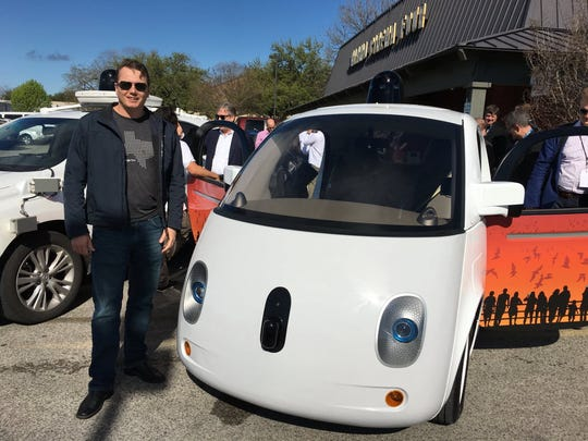 Chris Urmson, shown here at a South by Southwest Interactive with Google's prototype self-driving car, announced in 2016 that he would be departing the search company, where he was chief technology officer for its autonomous car project for seven years.