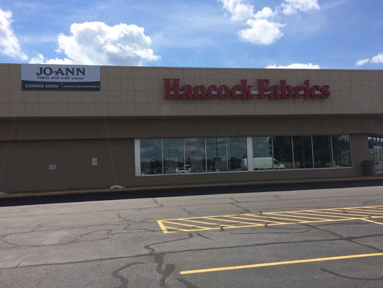 A coming soon sign for Jo-Ann Fabric and Craft Store
