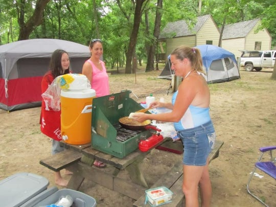 Jessica Hupman, Fair Grove, uses her camp stove to fix meals for her fellow campers.