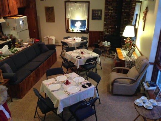 """he House of Prayer's former hospitality room, with its narrow entryway, outdated furniture, and folding chairs"""""""