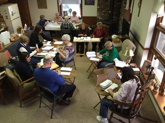 """Volunteers prepare a mailing within the House of Prayer's former hospitality room"""""""