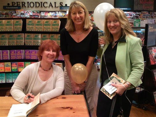 Author Janet Evanovich, left, likes to meet with her fans. Here, she poses, left, wtih Alice Arbogasrt and Annette Valyo at an Orlando, Florida, book signing earlier this month.  For FLORIDA TODAY