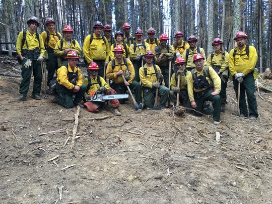 Firefighters from a Maryland crew pose for a photo