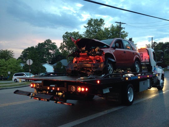 Crews tow a car from a crash scene on Grandview Road