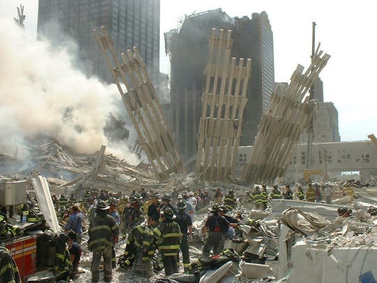 This photo taken by New York City firefighter Michael J. Leddy II, father of Dr. Michael J. Leddy III of Alexandria, shows firefighters sorting through the rubble at Ground Zero following the Sept. 11, 2001, terrorist attacks.