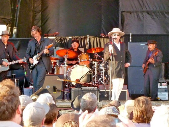 Bob Dylan and his band performing at the WaMu Theater in Seattle in 2009