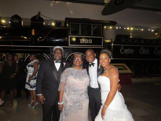 Chief Judge Carl Stewart and Mrs. Stewart, their son Kyle Stewart and his bride Lauren Eldridge at wedding festivities in Chicago.