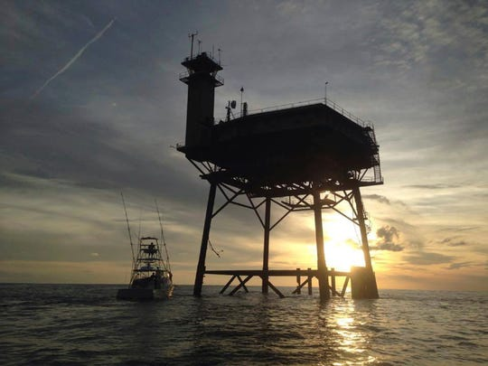 This photo provided by Jacob Jordan shows Frying Pan Tower. A North Carolina man and his fiancee are riding out Hurricane Matthew on top of the old Coast Guard light station more than 30 miles off the Atlantic coast. Richard Neal is the owner of Frying Pan Tower, a platform that is about 100 or so feet above the ocean, only reachable by helicopter or boat.