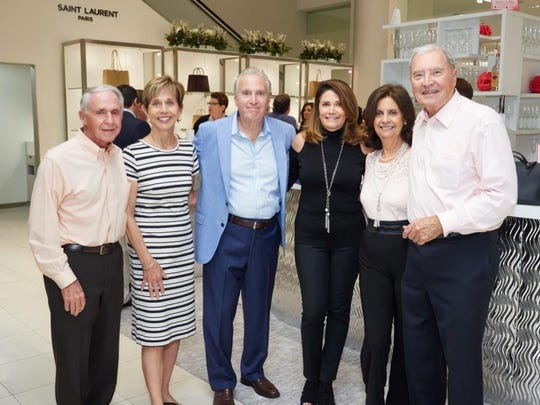 "Allen and Sandy Harrison (at left), Geoff and Jennifer Gitner, and Carole and Robert Hartless enjoy some fun shopping Oct. 26 at The Gardens Mall  during Jupiter Medical Center's annual ""Key to the Cure"" event, designed to help raise money and awareness for women's cancers. Jupiter Medical Center was a partner with Saks Fifth Avenue."