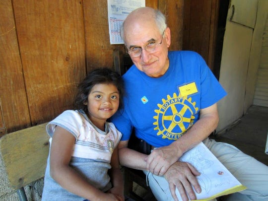 Elmbrook Rotary Club member Tom Curl meets with Yesenia, one of two children that he and his wife Linda sponsor in Guatemala.
