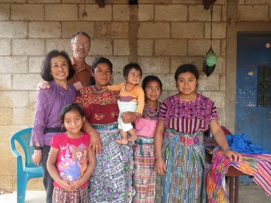 Elmbrook Rotary Club treasurer Erik Moeser (back) and his wife Carol sponsor two children in Guatemala including Lucy (front left).