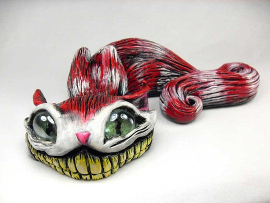 Jake Valentine's Cheshire-grinning cat look ready to