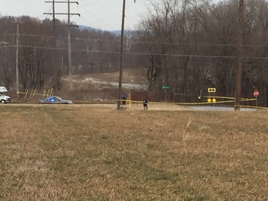 Police vehicles and yellow tape at a death investigation, Hokes Mill and Old Salem roads, West Manchester Township.