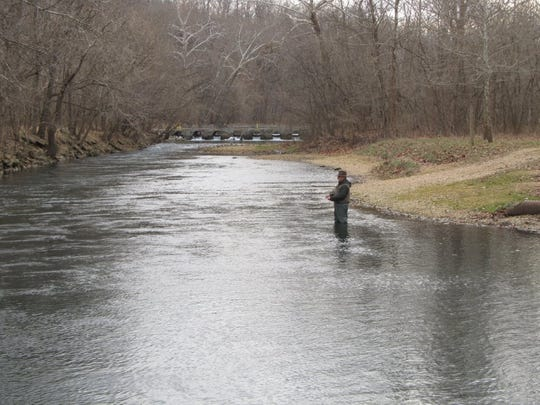 A lone angler tests the winter trout fishing at Bennett Springs.