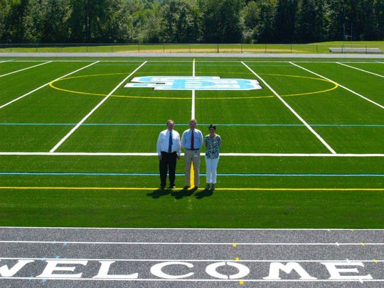 A shot of the new field with acting principals from