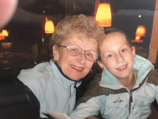 Allie LeClaire as a child with her grandmother, Carol