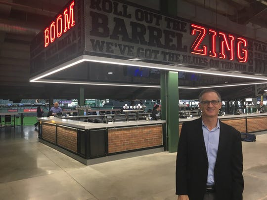 Brewers COO Rick Schlesinger shows off the new Zing Boom bar in right field.