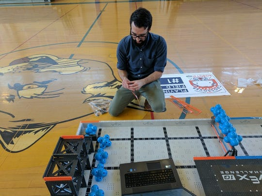 Shane MIller, the coordinator of the competition and adviser of the South Bergen Jointure Commission robotics team, put together the playing field for the March 29 competition at Carlstadt Public School.