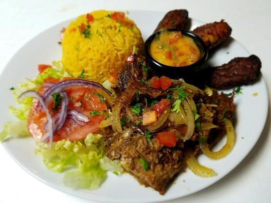 Hornado ecuatoriano - Ecuadorian roast pork - is a customer favorite at Mina's Bistro in Fort Myers.