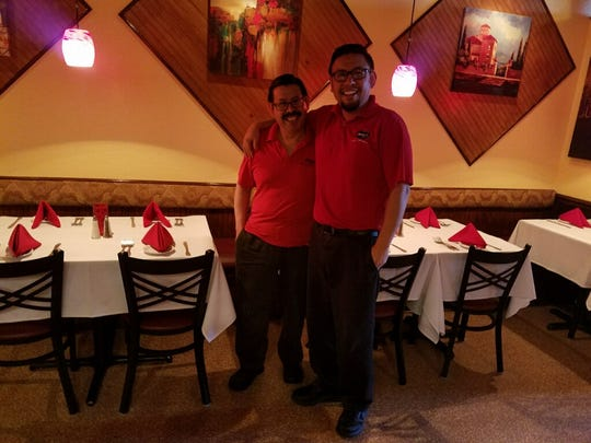 """Andre Benavides, right, owns Mina's Bistro in Fort Myers with his father, Jose, left, his mother, Helma, and his wife, Claudia. """"We thank all the customers for supporting local small business like us,"""" says Jose Benavides. """"Without them, we wouldn't be here."""""""