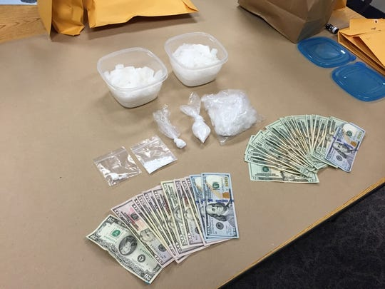 Methamphetamine, cocaine and money were recovered from