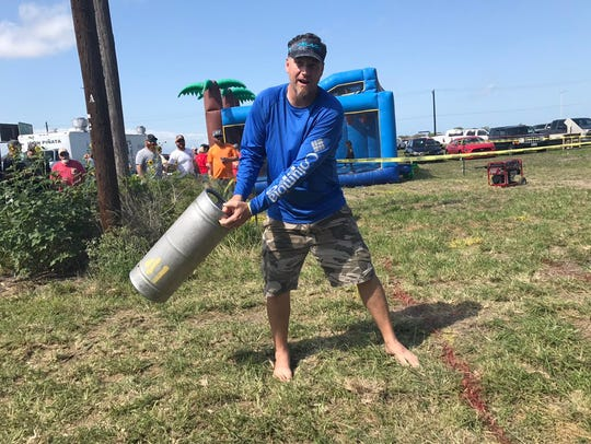 A patron at Corpus Christi Brewery Festival prepares