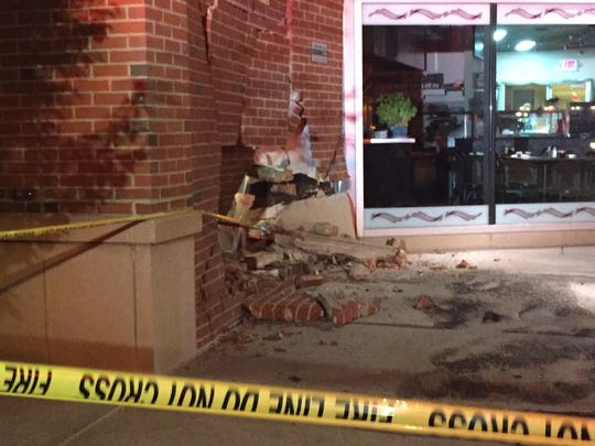 Damage to the Susquehanna Commerce Center after a car hit the building Wednesday night.