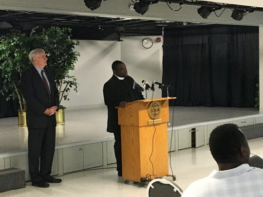 Milwaukee Mayor stands by while Pastor Michael McBride speaks Wednesday at the annual Ceasefire breakfast.