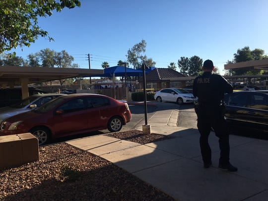 The apartment-complex parking lot in Tempe where two people were shot dead as they sat inside a vehicle on May 18, 2017.