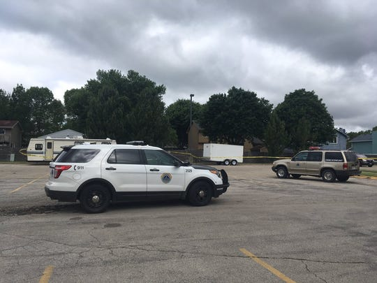 A police vehicle sits in the parking lot of Zion Lutheran