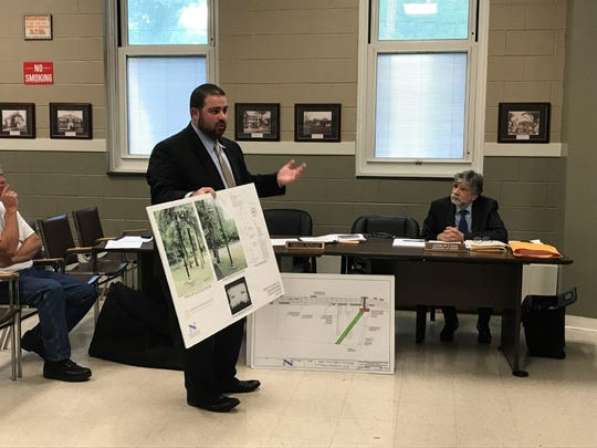Norwood Borough Engineer Evan Jacobs speaks at Wednesday's Borough Council meeting about a project to light the walking path at Kennedy Field.