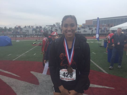 Palmyra's Camryn Simpson was all stmiles after winning her first state medal, in the long jump, on Saturday.