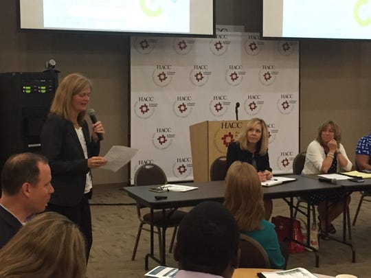 Susan Eberly (standing) introduces members of a discussion panel at Wednesday's Workforce Alliance Summit held at HACC-Lebanon Campus.