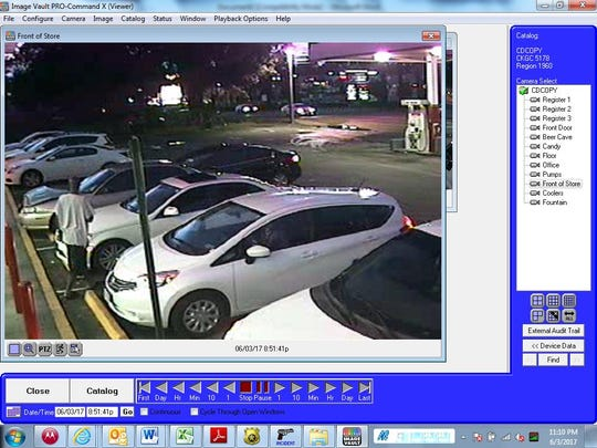 This screenshot of Circle K surveillance footage shows the suspect's outfit and the white Mercedes which was stolen.