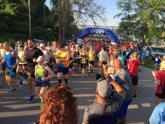 The beginning of the Walkway Marathon races on Sunday