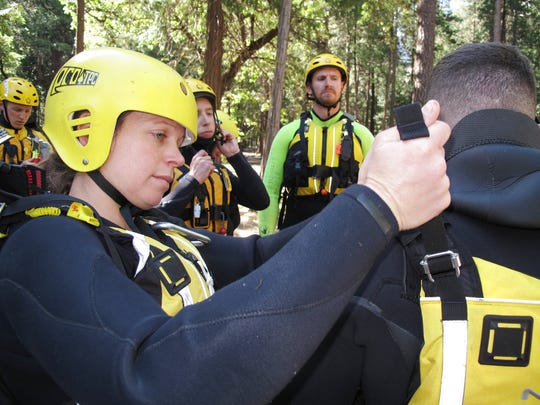 In this photo taken May 25, 2017, the swift water rescue team at Yosemite National Park, Calif., prepare for training in the frigid and swift water of the Merced River.