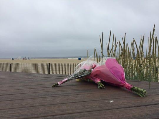Flowers on the Belmar boardwalk near where a borough teen died Thursday.