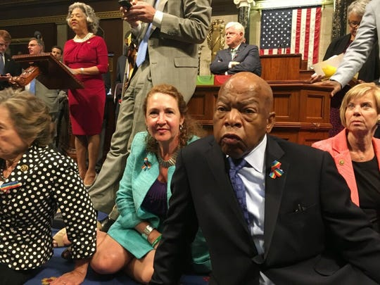 This photo provided by Rep. Chillie Pingree (D-Maine) shows Democrat members of Congress, including Rep. John Lewis (D-Ga., center) and Rep. Elizabeth Esty (D-Conn.) as they participate in a sit-down protest in the House of Representatives seeking a vote on gun control measures on June 22, 2016.