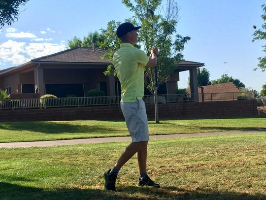 Pine View's Jaden Milne hits an approach shot on the
