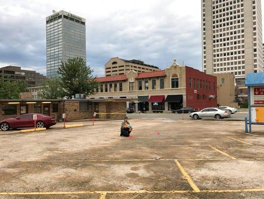 An investigator collects evidence near an Arkansas