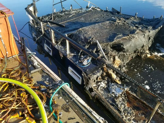 A 40-foot yacht went up in flames and sank at Sunset Cay, Thursday, July 6, 2017.