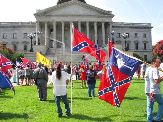 Dozens of people participate in a rally by the South Carolina Secessionist Party at the Statehouse on July 10, 2017.