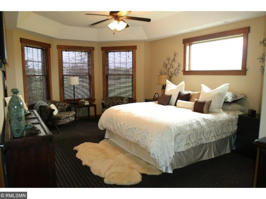 One of seven bedrooms at 41299 Stearns County Road 1, Rice.