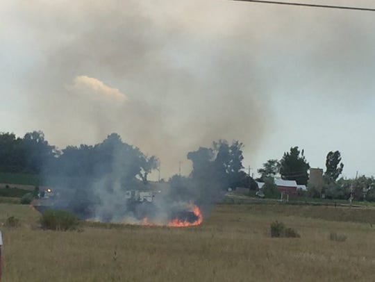 An approximately 15-acre fire burns near the intersection