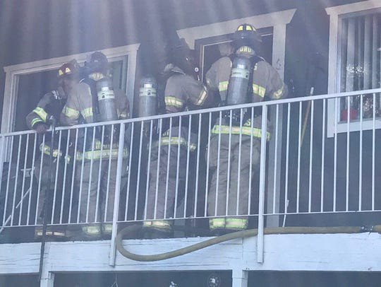 Redding firefighters work on an apartment fire on Masonic
